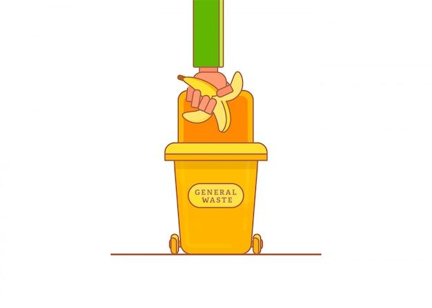 Bemannen sie die hand, die bananenstumpf im abfallbehälter wegwirft.