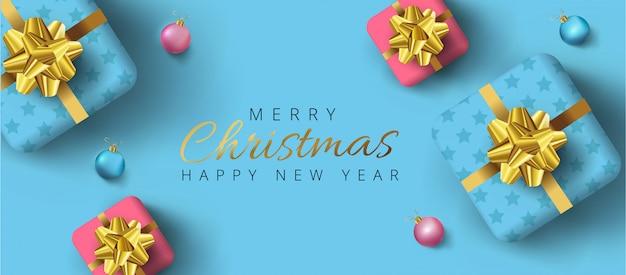 Beschriftung der frohen weihnachten und des guten rutsch ins neue jahr, realistische geschenkboxen