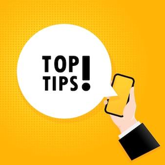 Beste tipps. smartphone mit einem blasentext. poster mit text top-tipps. comic-retro-stil. sprechblase der telefon-app. vektor-eps 10. auf hintergrund isoliert.