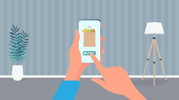 Bestellen sie lebensmittel und produkte telefonisch. essen zu hause bestellen. essen, hand hält ein smartphone.