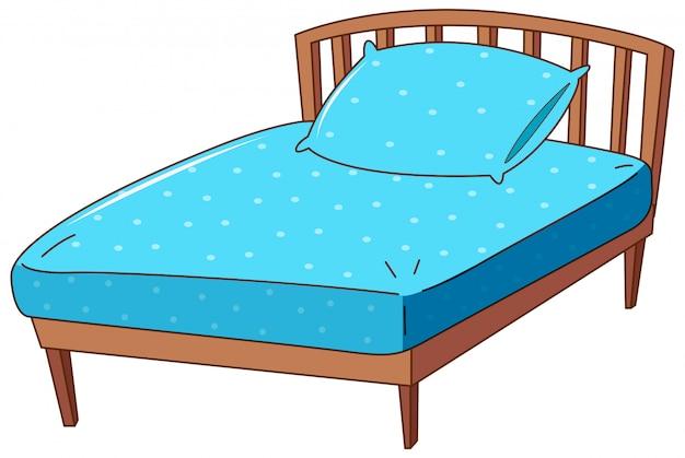 Bett mit blauem kissen und blatt