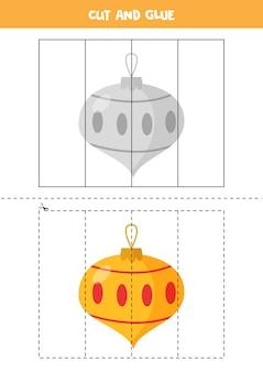 Bild der karikatur-weihnachtskugel schneiden und kleben