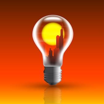 Bild einer glühbirne mit stadt im inneren