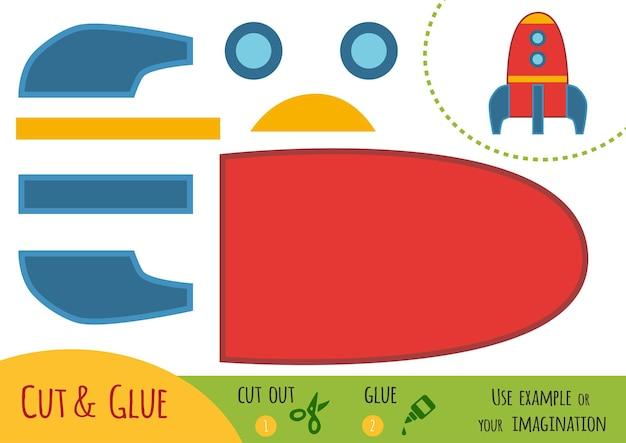 Bildungspapierspiel für kinder, raumschiff. verwenden sie schere und kleber, um das bild zu erstellen.
