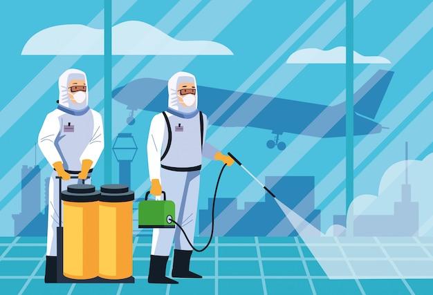 Biosicherheitsarbeiter desinfizieren den flughafen für