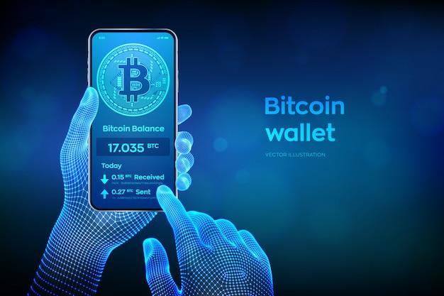 Bitcoin-geldbörsenschnittstelle auf smartphonebildschirm. nahaufnahmehandy in den wireframe händen.