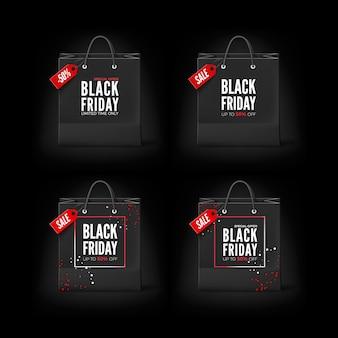Black friday konzept. satz schwarze papiertüten mit tag sale und text. schwarze freitag banner vorlage. isoliert auf schwarzem hintergrund
