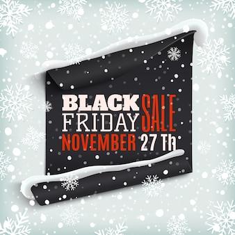 Black friday verkauf. gebogenes papierfahne auf winterhintergrund mit schnee und schneeflocken. winterverkauf. weihnachtsverkauf. neujahrsverkauf.