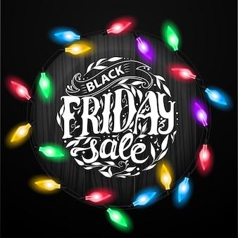 Black friday-verkauf. schriftzug mit weihnachtsgirlande