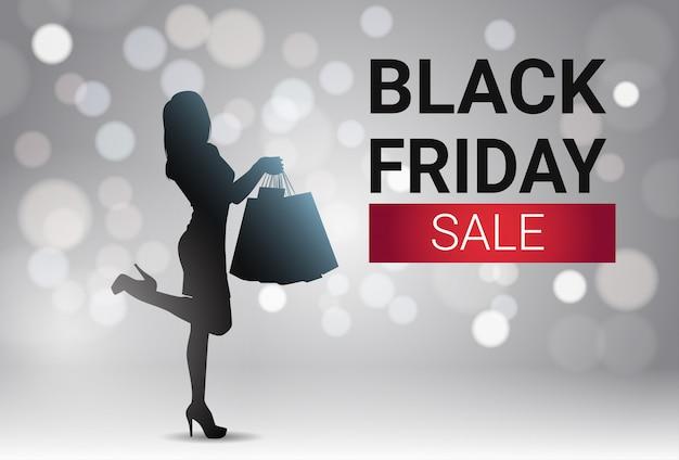 Black friday-verkaufsfahnen-design mit schattenbild-frau über weißen lichtern bokeh-hintergrund-feiertag