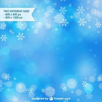 Blau winter hintergrund mit schneeflocken
