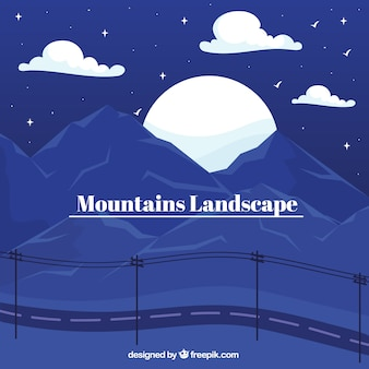 Blaue landschaft mit bergen, sonnenuntergang