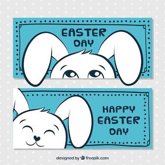 Blaue ostern banner mit lustigen kaninchen