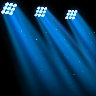 Blaue scheinwerfer auf dunklem hintergrund