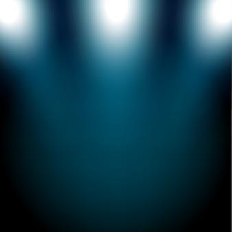 Blaue scheinwerfer, die auf dunklem hintergrund glänzen