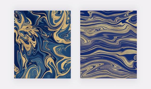 Blaue und goldene glitzertintenmalerei. abstrakte flüssige aquarellbeschaffenheit.