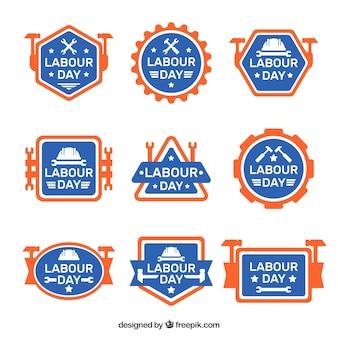 Blaue und orange etiketten für den arbeitertag