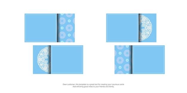 Blaue visitenkarte mit abstrakter weißer verzierung für ihre kontakte.