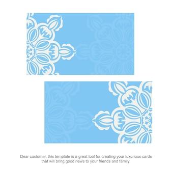 Blaue visitenkarte mit griechischen weißen ornamenten für ihre marke.