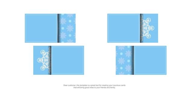 Blaue visitenkarte mit indischen weißen ornamenten für ihr geschäft.