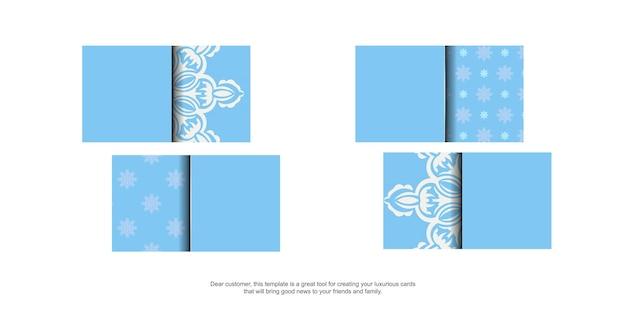 Blaue visitenkarte mit indischen weißen ornamenten für ihre marke.