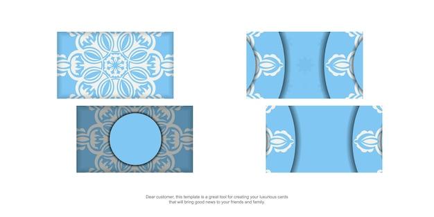 Blaue visitenkarte mit indischer weißer verzierung für ihre kontakte.
