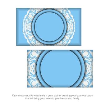 Blaue visitenkarte mit mandala-weiß-muster für ihre marke.