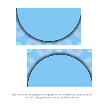 Blaue visitenkarte mit mandalaweißverzierung für ihre kontakte.