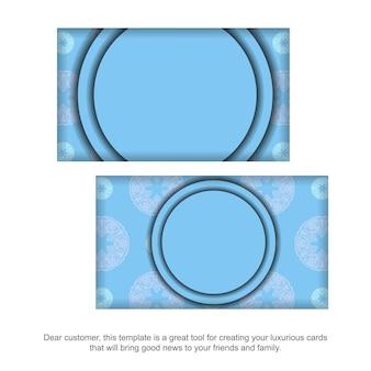 Blaue visitenkarte mit weißer verzierung der mandala für ihr geschäft.