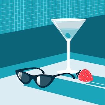 Blauer alkoholcocktail und sonnenbrille
