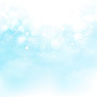 Blauer himmel der sonne sprengte dekorationssommerhintergrund