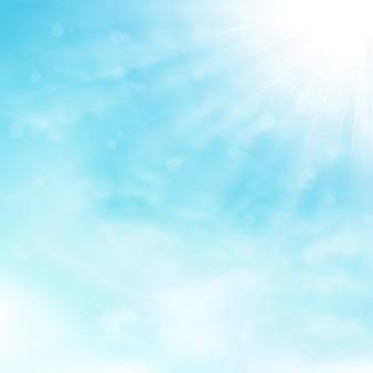 Blauer himmel und wolken mit sonnenexplosion und strahlnhintergrund.