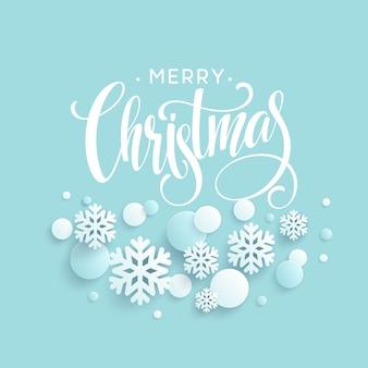 Blauer hintergrund der frohen weihnachten mit papercraft schneeflocke, beschriftungskarte grüßend.