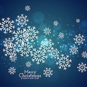 Blauer hintergrund der schneeflocken der frohen weihnachten