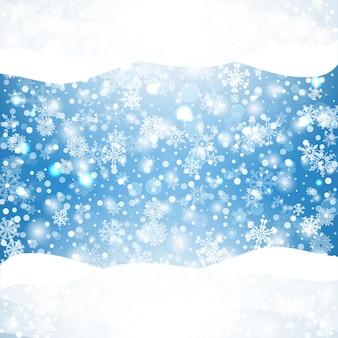 Blauer hintergrund der schneeflocken mit natürlichen flockenelementen