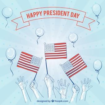Blauer hintergrund mit den händen und fahnen für tag des präsidenten
