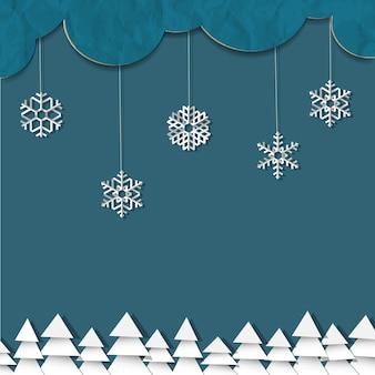 Blauer hintergrund mit papierschneeflocken und weihnachtsbäumen