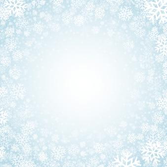 Blauer hintergrund mit schneeflockehintergrund