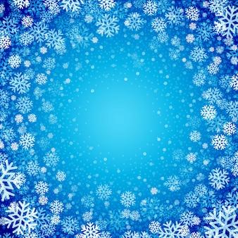 Blauer hintergrund mit schneeflocken, grußkarte