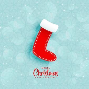 Blauer hintergrund mit weihnachtswintersocken