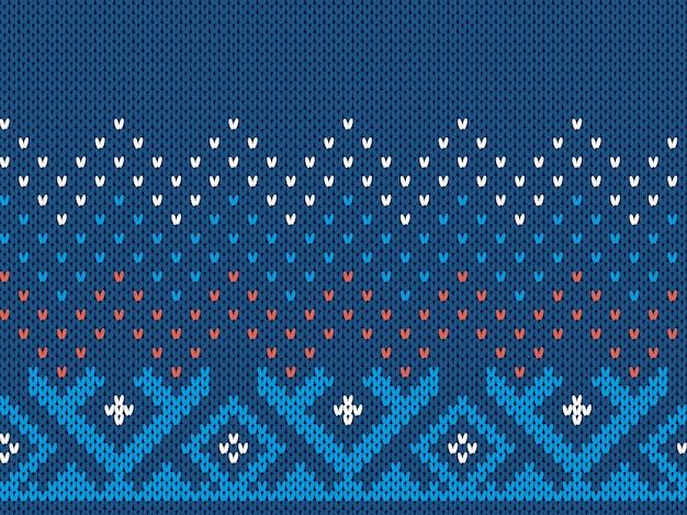 Blauer strickdruck. nahtloses weihnachtsmuster. pulloververzierung. weihnachtsbeschaffenheit. fairer inselhintergrund.