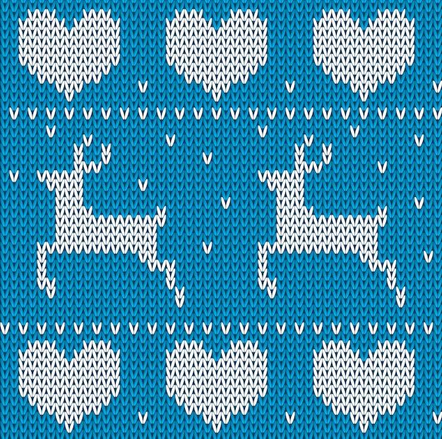 Blauer strickpullover aus hirschen im norwegischen stil. gestrickte skandinavische verzierung.