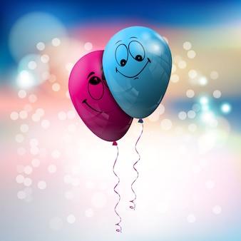 Blauer und rosafarbener ballon mit lustiger gesichtsbehandlung