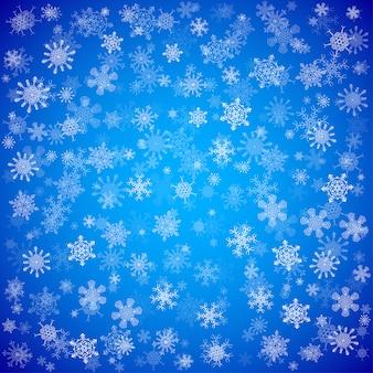 Blauer weihnachtshintergrund mit verschiedenen schneeflocken