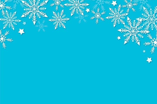 Blauer winterhintergrund im papierstil