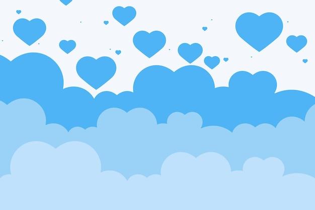 Blauer wolkenherzhintergrund