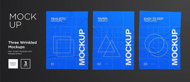 Blaues faltiges plakatschablonensatz. geklebtes papier. vektor realistische nasse faltige poster mockup