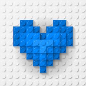Blaues herz aus kunststoff auf weißem hintergrund aus bausatz