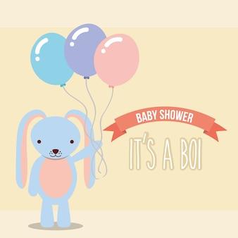 Blaues kaninchen, das ballon-babyparty-jungenkarte hält