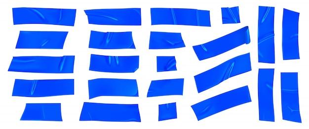 Blaues klebeband-set. realistische blaue klebebandstücke zur befestigung isoliert. papier geklebt.